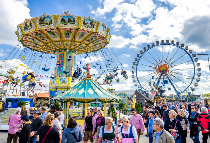 Munich, Germany - September 21, 2017: people and fairground rides at the biggest folk festival in the world - the octoberfest on september 21, 2017 in munich. Since 1810 it takes place on the Theresienwiese in the Bavarian state capital Munich.
