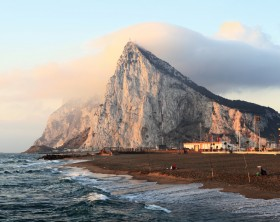 The rock of Gibraltar at sunrise as seen from the coast of Southern Spain.   [url=http://www.istockphoto.com/my_lightbox_contents.php?lightboxID=1873311] View similar photos in my portfolio[/url]