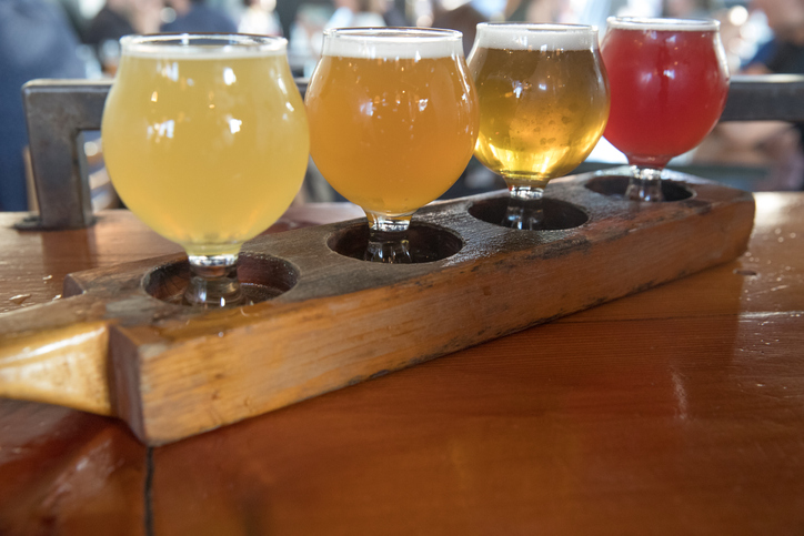 A craft beer tasting flight is on display featuring several styles of small batch local beers.