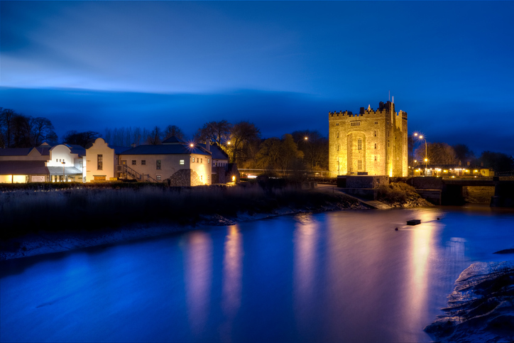 Bunratty castle with reflection in the river at night - HDR