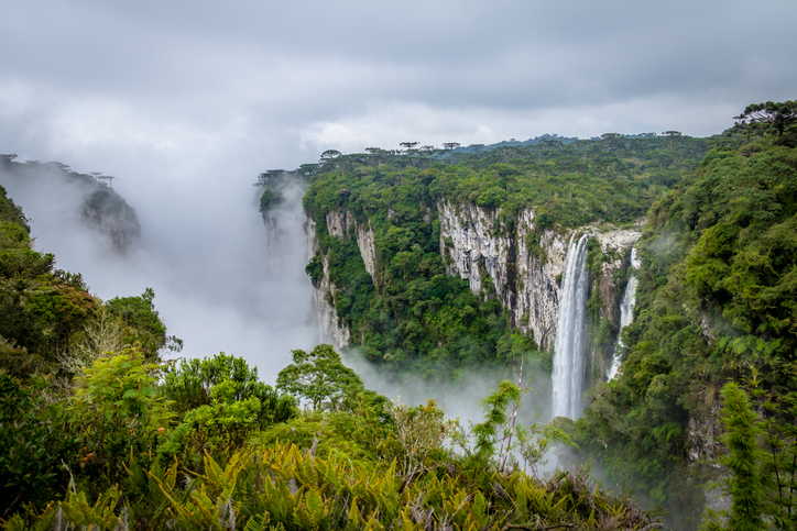 Waterfall of Itaimbezinho Canyon with fog at Aparados da Serra National Park - Cambara do Sul, Rio Grande do Sul, Brazil