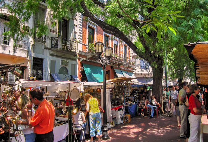 Tourists shop in San Telmo flea market, a popular attraction in old town Buenos Aires, Argentina.