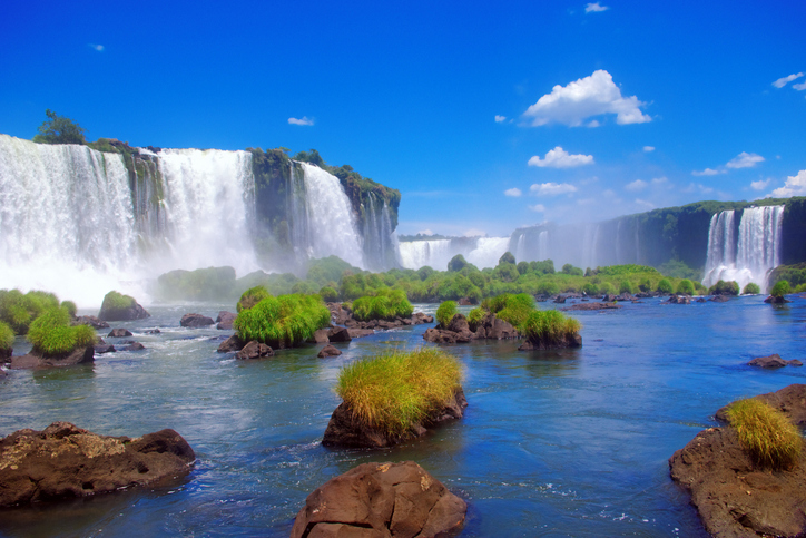 """One of the natural wonders of the world is the Iguacu Waterfalls, located on the border of Brazil and Argentina."""