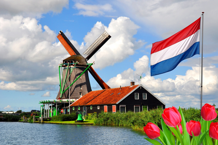 Traditional dutch windmill and house in Zaanse Schans, Netherlands, Europe