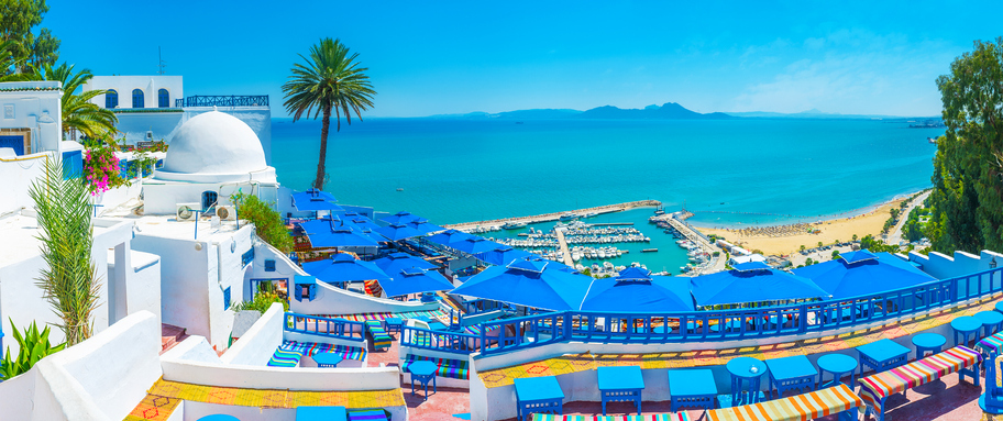 Sidi Bou Said, Tunisia - August 31, 2015: Sidi Bou Said boasts luxury restaurants and amazing viewpoints, overlooking its beaches, port and Cap Bon, seen on horizon, Tunisia.