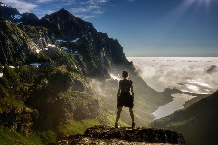 Woman hiking in high mountains, Hermannsdalen, Lofoten