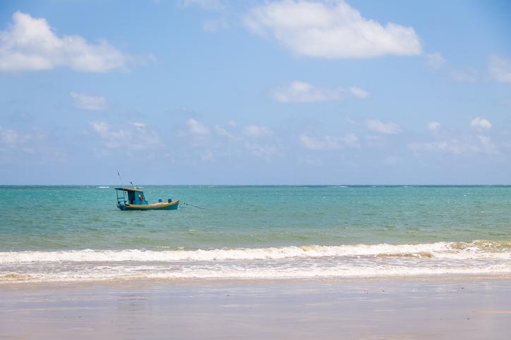 Small Fishing boat in brazilian coast - Pirangi, Rio Grande do Norte, Brazil