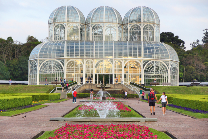 Curitiba: People visit famous Botanical Garden of Curitiba, Brazil. The garden was opened in 1991 and covers 240.000 m2 in area.
