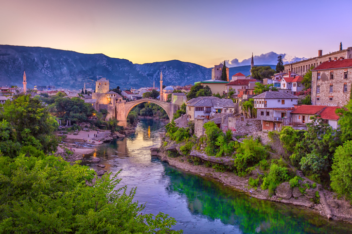 The Neretva river winding through the old UNESCO listed, Mostar bridge in Bosnia and Herzegovina.