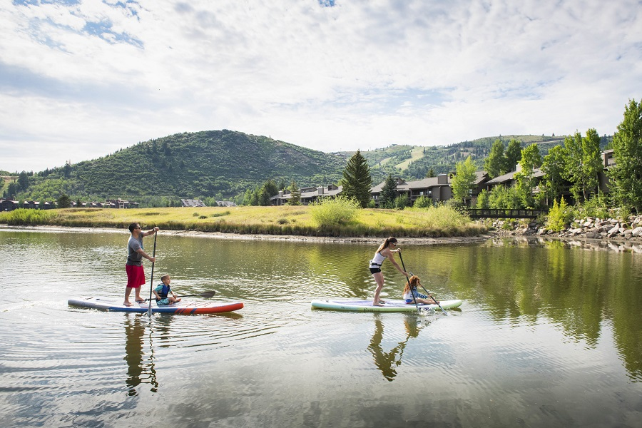 family-paddleboarding-on-deer-valley-pond