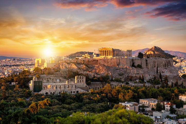 View to the Parthenon Temple at the Acropolis of Athens above the old town Plaka during sunset time, Greece