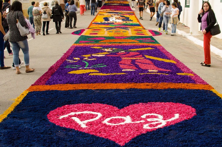 São Paulo, Brazil, June 15, 2017: Confection of the traditional saw carpets of Corpus Christi, in Santana de Parnaíba (SP). Carpets are instituted by the Church to exalt the love of the Body of Christ. The faithful assemble the rugs through the streets with words and figures relating to the subject of the procession.