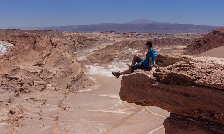 Hiker on coyote's rock near San Pedro de Atacama, Chile
