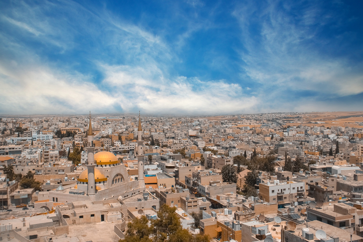 wide shot view over the town center of Madaba in Jordan with the Central Mosque. Landscape of Jordan