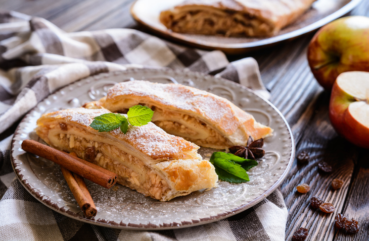 Traditional puff pastry strudel with apple and raisins filling