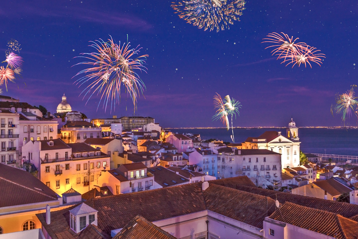 Assembly of fireworks above the district Alfama at new years eve in the portuguese capital.