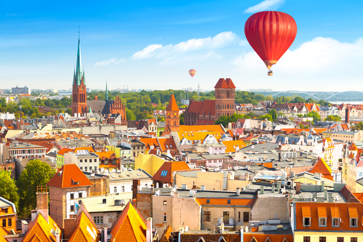 Aerial panoramic view of historical buildings and roofs in Polish medieval town Torun, Poland