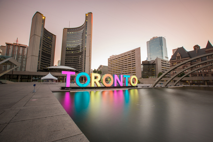 Toronto, Ontario, Canada - September 1, 2016:  Toronto City Hall, as seen from Nathan Philips Square in downtown Toronto at sunrise.