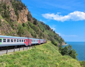 Kirkirey, Irkutsk region, Russia  - July, 29,2016: Baikal Express. Tourist train travel. Organised tour of Circum-Baikal Railway. Route passes through picturesque shore of deep lake