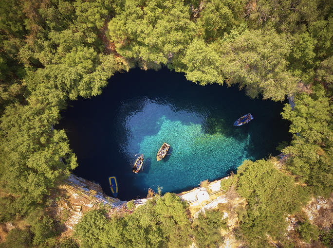Aerial view of Melissani cave ( Melissani Lake ) in Kefalonia island, Greece
