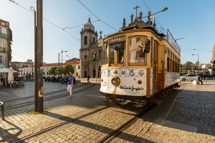 Old Fashioned trolley car outside of Carmo Church (Igreja do Carmo) in Porto, Portugal.
