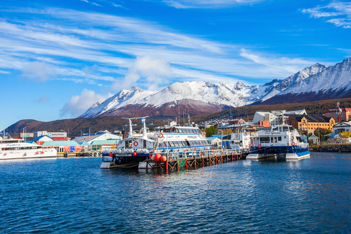 USHUAIA, ARGENTINA - APRIL 15, 2016: Catamaran boats in the Ushuaia harbor port. Ushuaia is the capital of Tierra del Fuego province in Argentina.