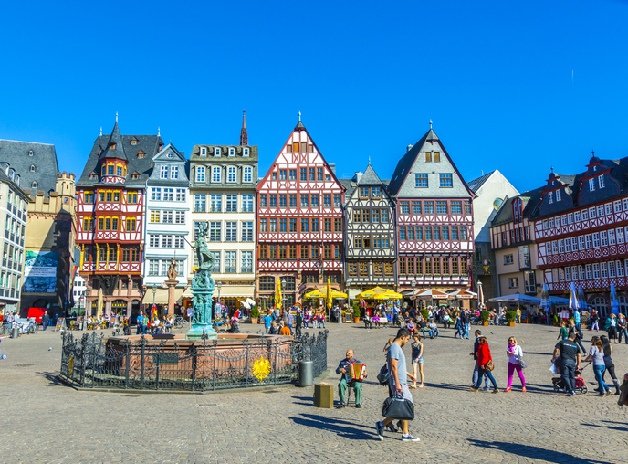 Frankfurt, Germany - March 25, 2012: People on Roemerberg square in Frankfurt, Germany. Frankfurt is the fifth-largest city in Germany, with a population of 687,775.