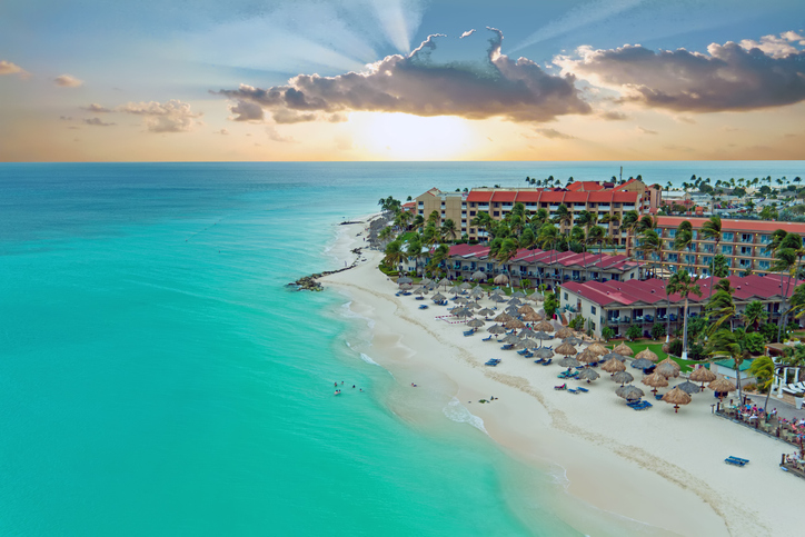 Aerial from Manchebo beach on Aruba island in the Caribbean at sunset