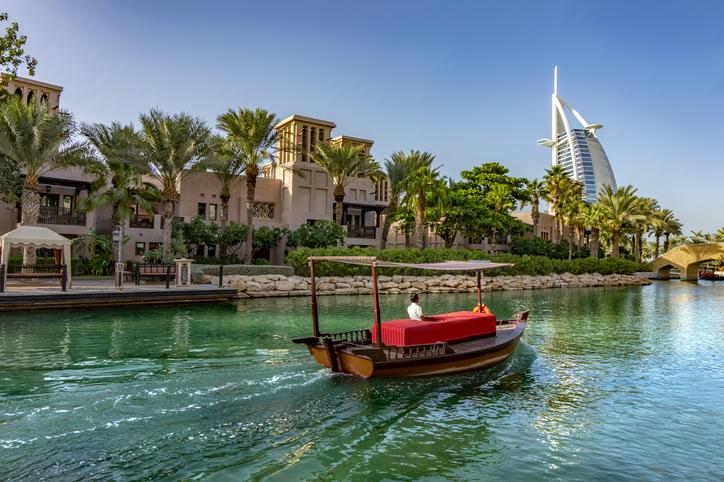 Dubai,UAE 11. 03. 2018 : abra boat ride in souk medinat jumeirah with the burj al arab