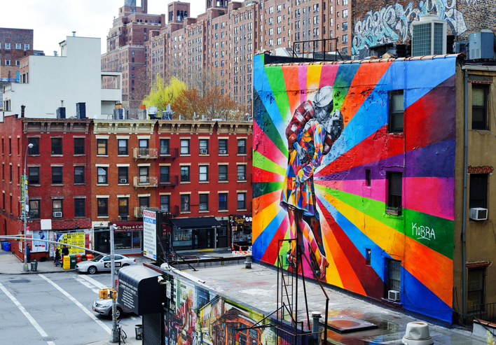 New York, New York, USA - April 13, 2013: Traffic in Chelsea by a mural by artist Brazilian artist Kobra. The colorful mural is based on Alfred Eisenstaedt's photo from V-J Day in Times Square.