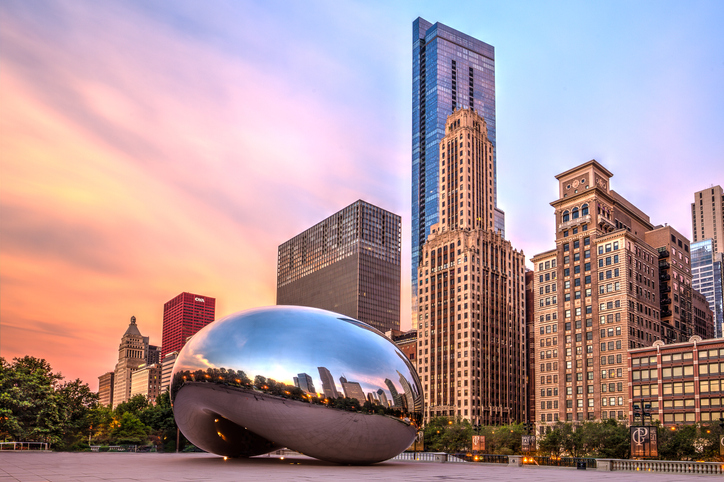 "Chicago, USA - July 2015: The sculpture ""Cloud Gate"" also nicknamed ""The Bean,"" located in Millennium Park, Chicago, Illinois. Sculpture was created by Anish Kapoor."