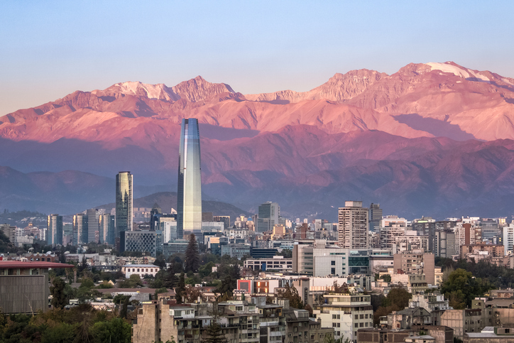 Aaerial view of Santiago skyline at sunset with Costanera skyscraper and Andes Mountains - Santiago, Chile