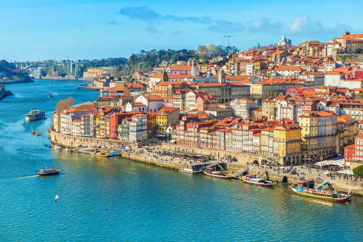 Cityscape of Porto (Oporto) old town, Portugal. Valley of the Douro River. Panorama of the famous Portuguese city. Popular tourist destination.