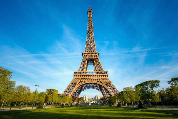 Landscape panoramic view on the Eiffel tower and park during the sunny day in Paris, France. Travel and Vacation concept.