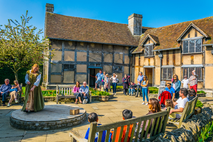 Stratford, UK, April 8, 2017: Actors are performing pieces of Shakespeare's plays in his birth house in Stratford upon Avon, England