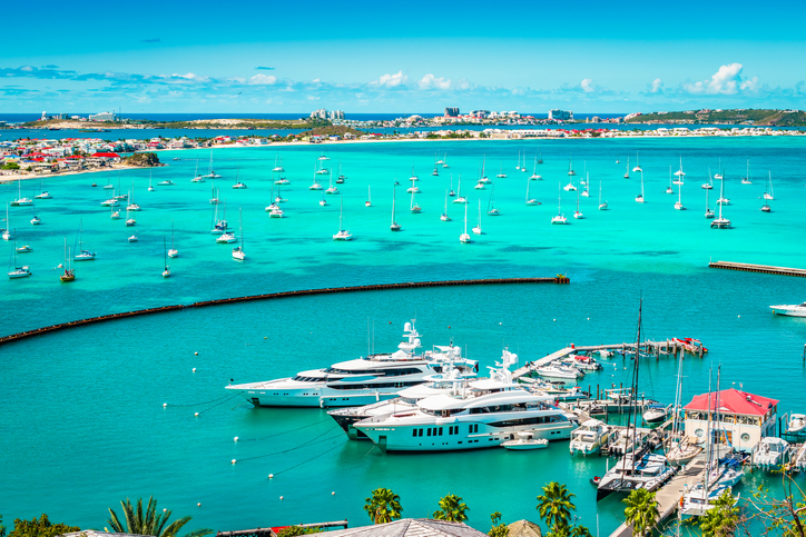 Bright and colorful harbor view with yachts and boats in the marina of Marigot in Saint Martin, French side of the Caribbean Island.