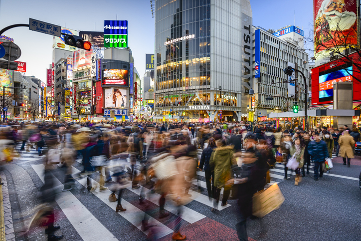 Tokyo, Japan - December 24, 2012: Pedestrians cross at Shibuya Crossing. The scramble crosswalk is one of the busiest in the world.