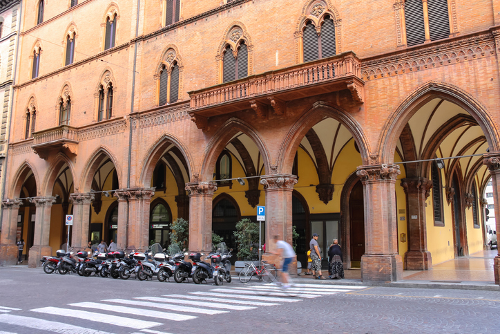 Bologna, Italy - August 18, 2014: People and bike on the street Indipendenza in Bologna, Italy