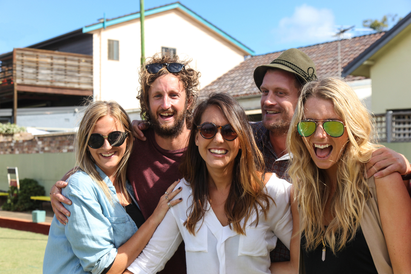 A group of friends having fun together at bowls at Bondi Australia.