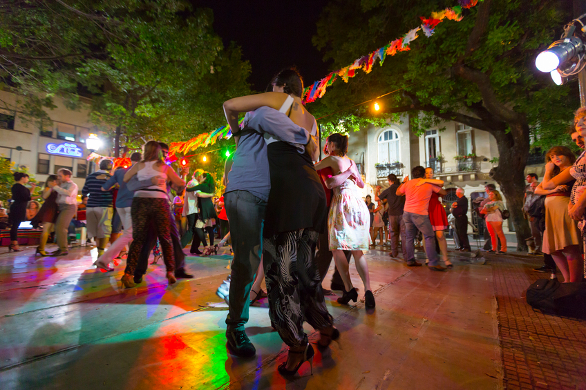 Buenos Aires, Argentina  - November 17, 2014: Group of people dancing the tango at night on the main square of San Telmo in Buenos Aires, Argentina 2014