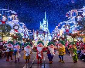 """Dressed in their holiday finest, the Seven Dwarfs parade down Main Street, U.S.A., at Magic Kingdom during """"Mickey's Once Upon a Christmastime Parade."""" The festive processional is one of the happy highlights of Mickey's Very Merry Christmas Party, a night of holiday splendor with lively stage shows, a unique holiday parade, Holiday Wishes: Celebrate the Spirit of the Season nighttime fireworks, and snow flurries on Main Street, U.S.A. The special-ticket event takes place on select nights in November and December in Magic Kingdom at Walt Disney World Resort in Lake Buena Vista, Fla. (Ryan Wendler, photographer)"""