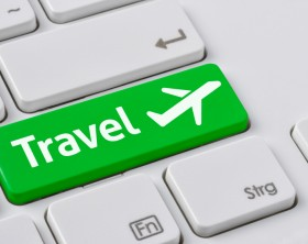 A keyboard with a green button - Travel