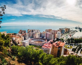 Picturesque view of Malaga bullring (La Malagueta) and seaport. Spain
