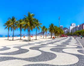 Copacabana beach with palms and sidewalk in Rio de Janeiro, Brazil