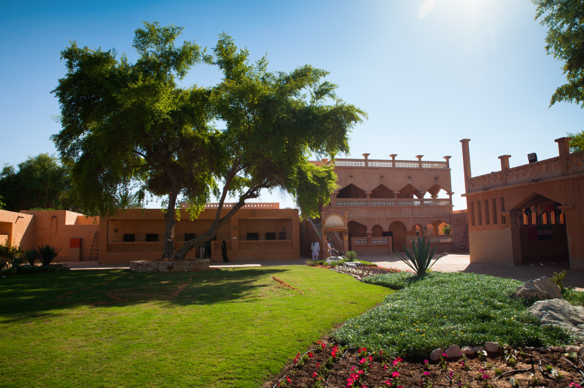 Al Ain, United Arab Emirates - November 30, 2013: Gardens of the Palace Museum of Sheik Zayed in Al Ain Oasis. This is where the creator of UAE, Sheik Zayed was grown up and spent most of his life. The Palace Museum is a popular tourist destination in UAE.