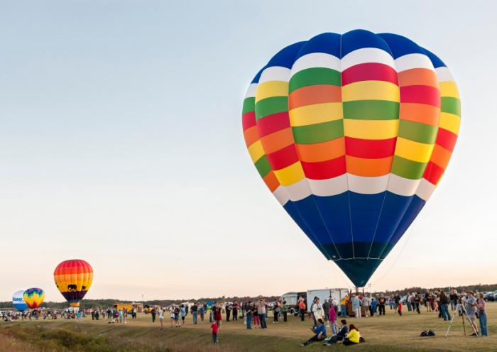 QUEENSBURY, New York, USA - SEPTEMBER 20, 2013: The crowds watch how the hot air baloons are inflated before their launch at Adirondack Balloon Festival
