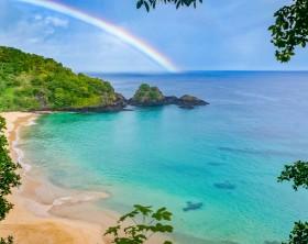 Rainbow in Praia do Sancho beach in Fernando de Noronha, Brazil