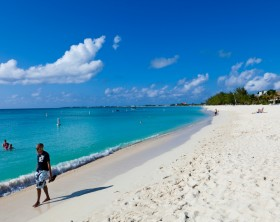 Seven Mile Beach, Grand Cayman, Cayman Islands - November 30, 2009: People relaxing on the beautiful SMB, acronym for Seven Mile Beach, a long crescent of coral-sand beach located on the western shore of Grand Cayman.