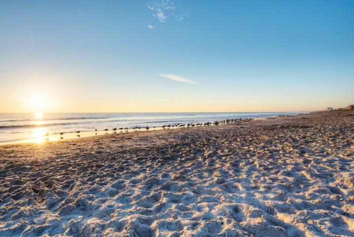 """Cocoa Beach, Florida at Sunrise with Clear Sky."""
