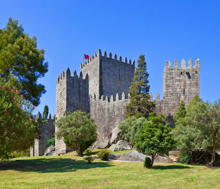 Guimaraes, Portugal - July 28, 2013: Guimaraes Castle, the most famous  castle in Portugal as it was the birth place of the first Portuguese King and the Portuguese nation. Unesco World Heritage Site.
